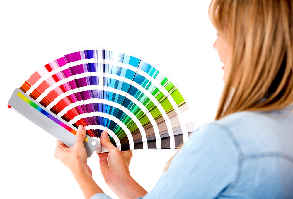Designer holding color options for a new home
